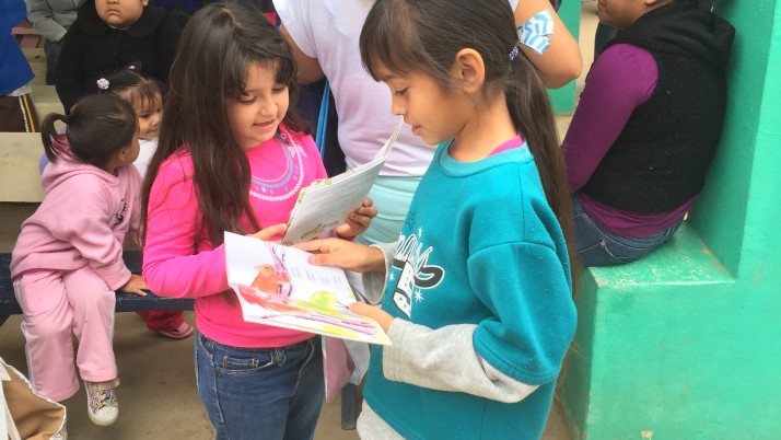 Baja migrant children enjoy books brought by the Flying Samaritans